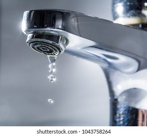 Water faucet close up with drops in - Dropping tap