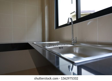 water faucet closed and stainless sink cooking in kitchen room