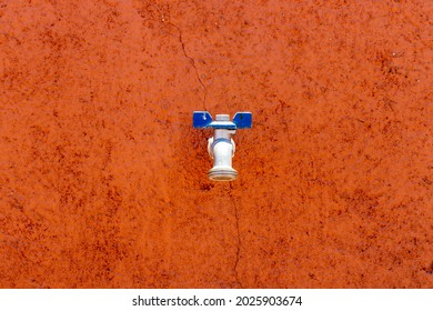 water faucet on a colorful wall