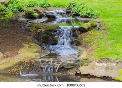Water feature in a garden in the summertime in the day