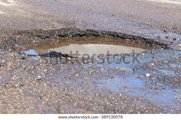 Shutterstock & Water Filled Pothole Wet Road Focus Stock Photo (Edit Now ...