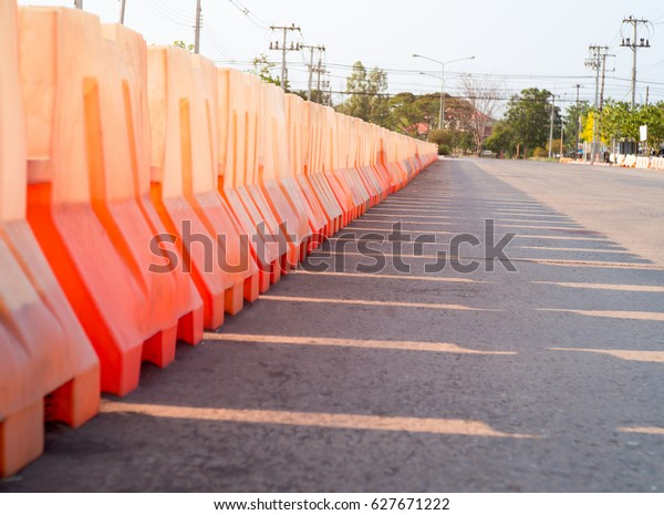 Water Filled Red Plastic Barriers Row Stock Photo (Edit Now