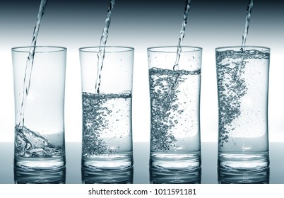 Water filling four glasses in sequence