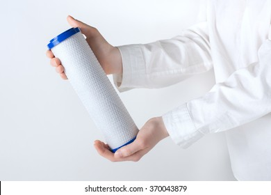 water filter cartridge in human hands