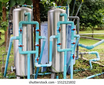 Water filter cleaning system in the garden used to purify fresh water for drinking and household consuming. Small water supply system for home and small business use