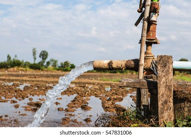 Water flow from large pump tube in rice field of Thailand, Focus on tube,selective focus.