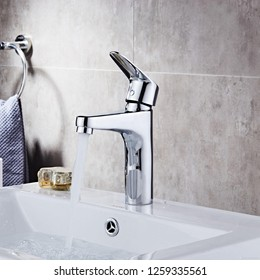 Water flow from the modern basin mixer.