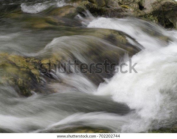 Water flow on rock at the Nakhon Nayok, Thailand.