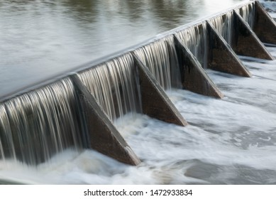 The water flow pass the weir from upper level to lower level - Shutterstock ID 1472933834