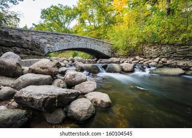 Water flow under bridge in Minnesota during autumn