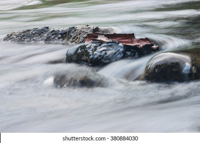 Water flowing over rocks in a stream