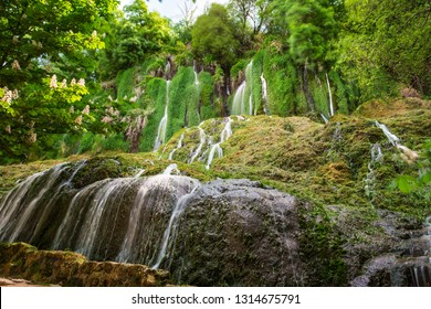 Water flowing over the stones and green musk in the course of the Piedra River in Aragon, Spain. Long exposure.