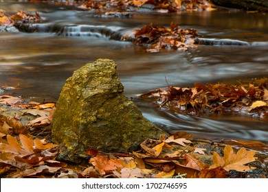 Water flowing round rocks in the Smoky Mountains during fall