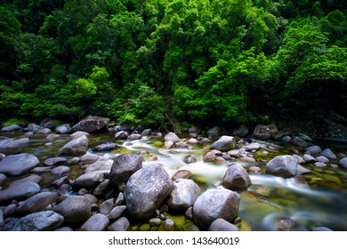 Water flowing slowly over rocks and boulders at Mossman River Daintree National Park.