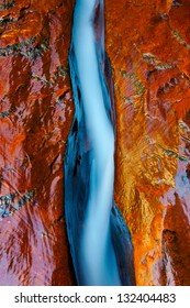 Water flowing through fissure in red rock, Zion National Park, Utah
