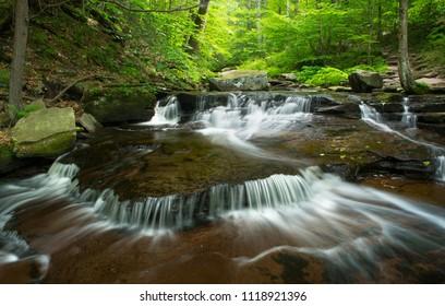 Water flowing through rocky stream