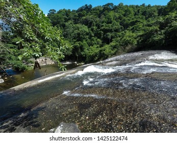 Water flowing in waterfall with florest on backgorund