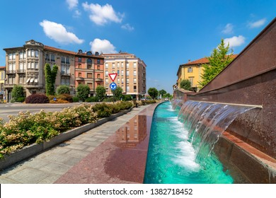Water flows in modern fountain on Piazza Ferrero - central town square in Alba, Piedmont, Northern Italy.