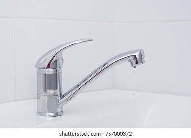 water flows from an open tap in the bathroom