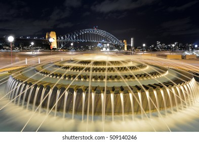 Water fountain against Sydney Harbour Bridge at night in Sydney New South Wales, Australia.