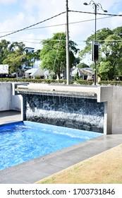 Water fountain around swimming pool.