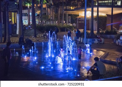Water fountain at night with people at Darling Quarter in Sydney,Australia/Water and Light/SYDNEY,NSW,AUSTRALIA-NOVEMBER 21,2016: People enjoying water fountain at Darling Quarter in Sydney,Australia