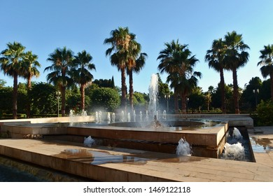 Water fountain and palm trees in Granada city park (Federico García Lorca Park), Andalusia, Spain