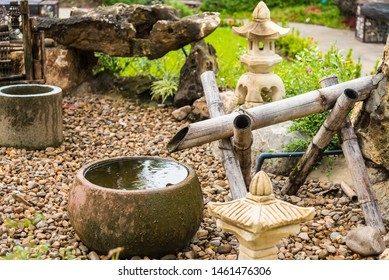 Water Fountain with Stone Basin and Bamboo Spigot and Stone Lantern at Garden