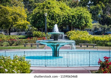 Water fountain surrounded by blooming roses in the Municipal Rose Garden, San Jose, south San Francisco bay area, California