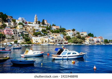 The water front on the Island of Symi with the church of The Annunciation standing on the hill above the fishing boats.