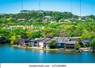 Water front property real estate mansions and luxury living on the water at town lake along Colorado river  near Mount Bonnell in Austin , Texas , USA