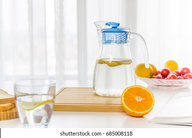 water with fruit, lemon and ice?near the window?bread