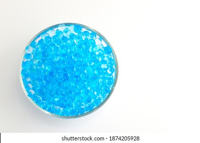 Water gel balls in a glass bowl, isolated on white with copy space