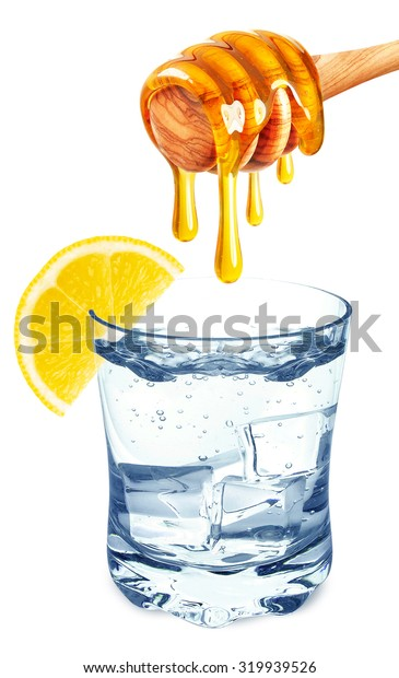 water in a glass with honey and lemon isolated on white background