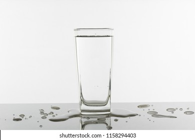 Water glass on white background. Glass with clean drinking water.