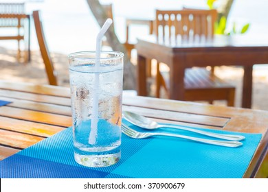 water in glass on a wooden table