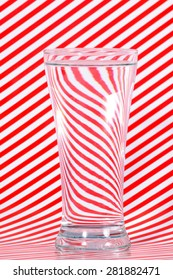Water in glass with red lining