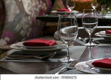water glasses on table with other eating utensil