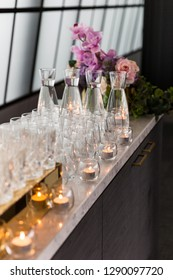 Water & glassware arrangement on the bar ready for an social event.