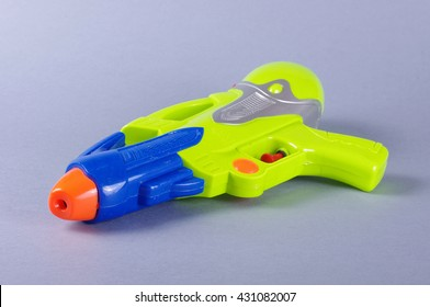 Water gun toy isolated on the gray background
