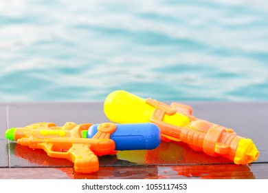 Water guns nearby the swimming pool
