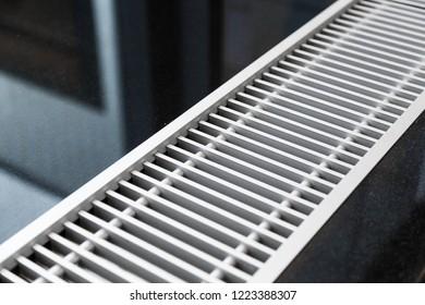 Water heater embedded in floor