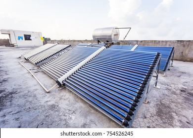 Water heating solar panels on a building roof, India