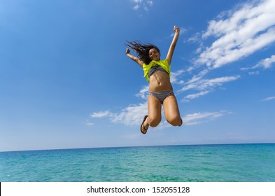 Water horizon happy teen jump. Happy teen smiling jump isolated on sea clear water horizon and blue sky