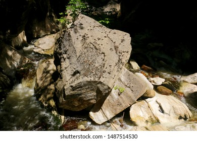 Water from the Hudson Brook flows past a large boulder in Natural Bridge State Park in North Adams, Massachusetts