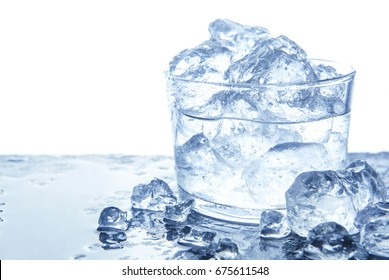 Water with ice cubes in glass. Isolated on white, copy space