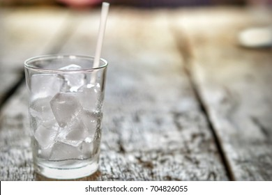 Water ice in glass on wood,close up.