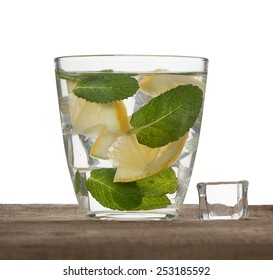 water, ice, lemon and mint isolated on white background