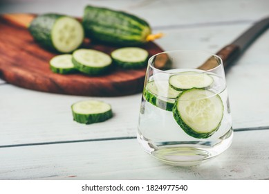 Water infused with sliced cucumber in a drinking glass