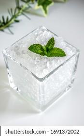 Water kefir also called tibicos grains in glass jar on white shelf